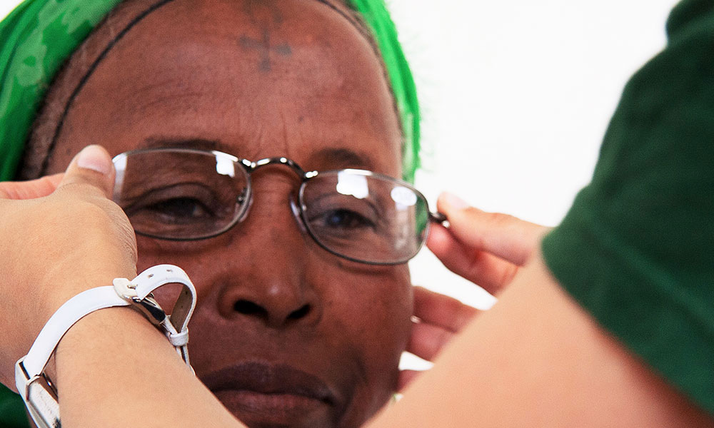 A patient receives her spectacles