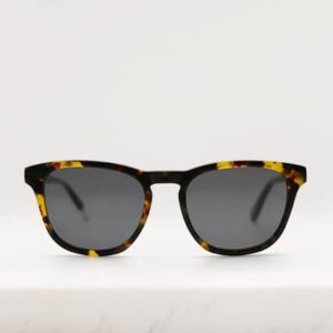Front view of Pala eco sunglasses frame in maple colour tortoiseshell bio-acetate with grey polarised lenses