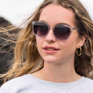 woman wearing grey oversized sustainable sunglasses