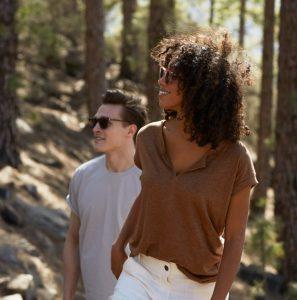 male and female wearing bio-acetate sunglasses