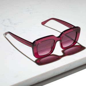 red berry sunglasses on marble slab