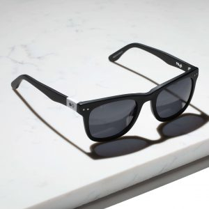 black wayfarer sunglasses on marble
