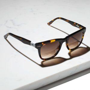 tortosieshell wayfarer sunglasses on marble