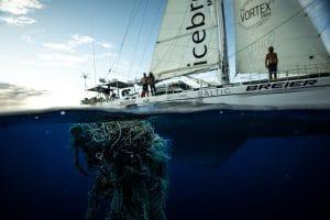 plastic waste in sea beside yacht