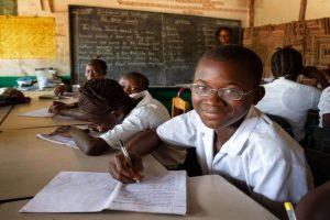 Boy wearing prescription glasses at school