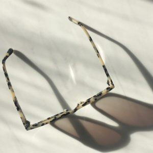 sustainable sunglasses on marble slab