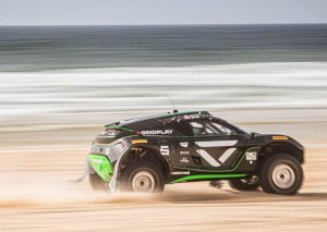 veloce e-extreme car racing on sand