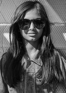 young girl wearing Pala sustainable sunglasses