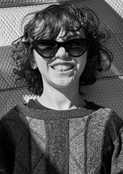 young boy wearing Pala sustainable sunglasses