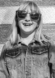 young girl wearing Pala ethical sunglasses