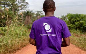 man wearing vision aid overseas t-shirt