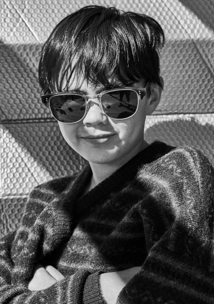 young boy wearing Pala ethical sunglasses